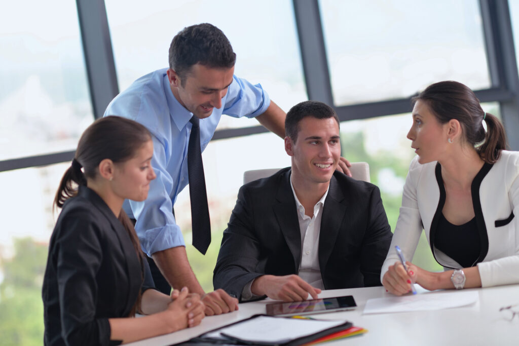 An estate planning team of professionals meet with client to discuss goals.