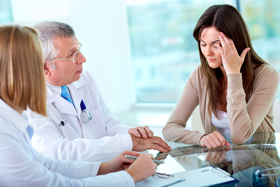 College student with healthcare power of attorney discusses health issues with physicians