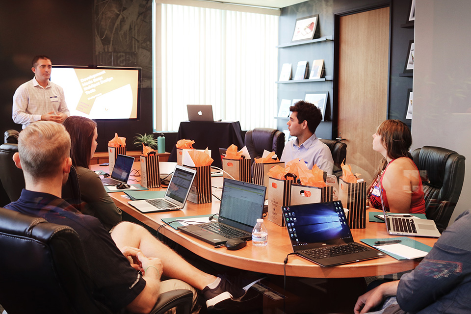 Employees discuss new FLSA overtime thresholds in conference room
