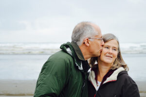 Elderly couple on the beach have estate plan in place