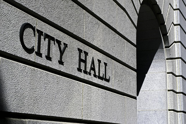 sign that reads city hall on side of building