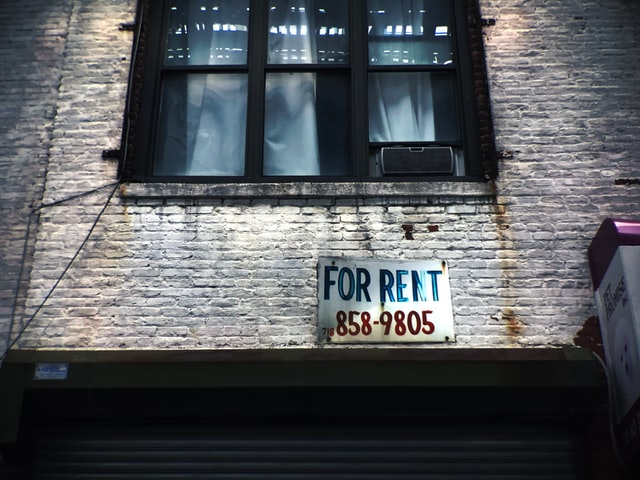 Apartment with For Rent Sign