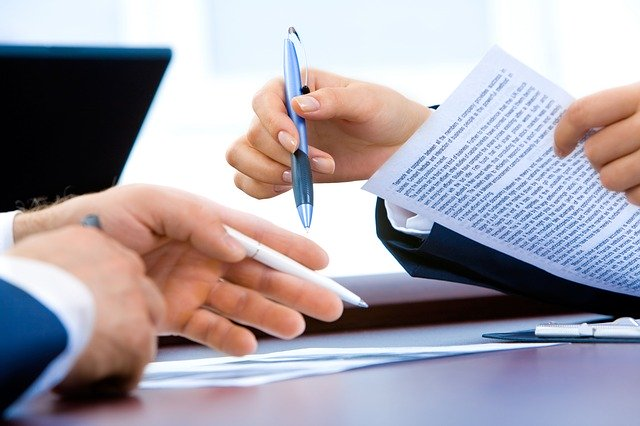 hands of two people signing documents pa now allows remote notary services