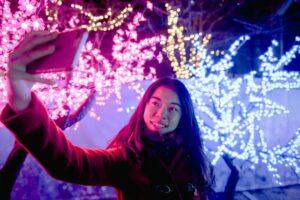 woman taking selfie to post on social media sites