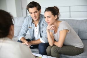 married couple discuss benefits of seperate revocable trusts