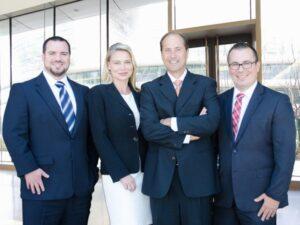 The Lynch Law Group leadership team includes Attorneys Dan Lynch, Charles Hadad, Krista Kochosky