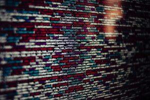 multicolored programming code on black screen