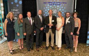 The Lynch Law Group attorneys pose with award at 2021 Fast 50 Awards