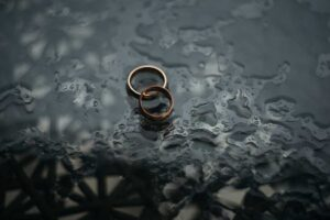 wedding rings on a table in the rain